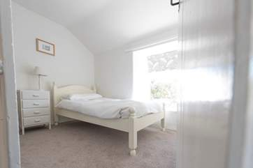 The single bedroom where there is also room for a travel cot.