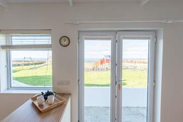 The kitchen/diner has sea views and over looks the village play area.