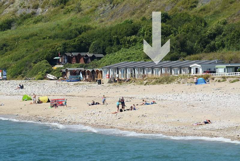 The Chalet on the Beach is one of a group, with private parking to the rear of the chalets.