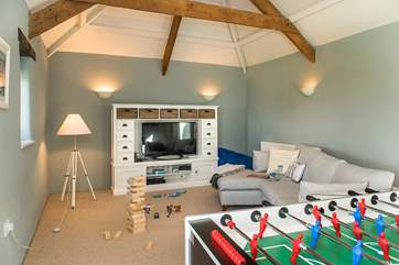The second sitting-room has plenty of games to keep everyone entertained.