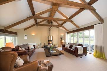 The large sitting-room has plenty of space for everyone to relax with the wood-burner taking centre stage.