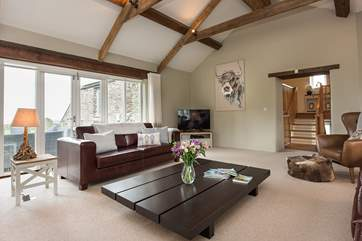 The sitting-room is fabulous with high vaulted ceilings.