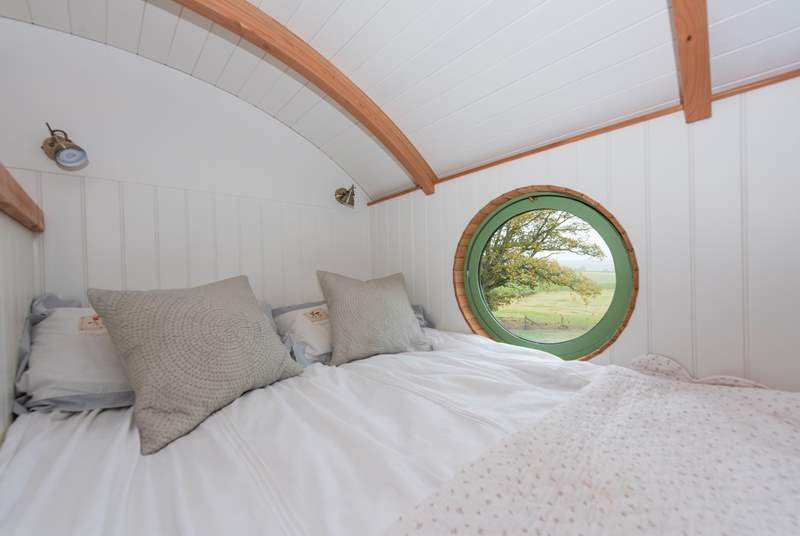 What a beautiful view from the double bed with its luxury bed linen.