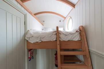 The cosy double bed with its beautiful view is accessed by a ladder (please take care).