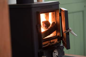 The warming wood-burner ensures cosiness what ever the time of year.