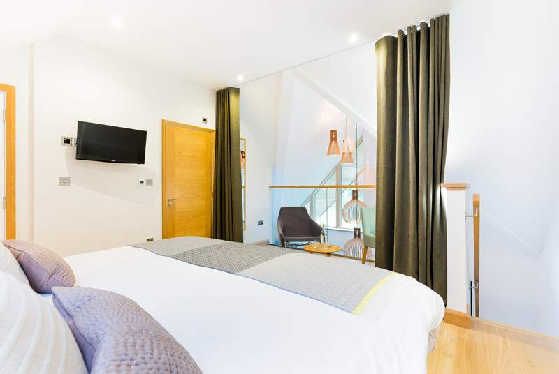 The master bedroom on the top floor is light and spacious with a dressing-room next door and an en suite shower-room.