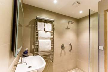 Fully tiled, luxury bathrooms for everyone.