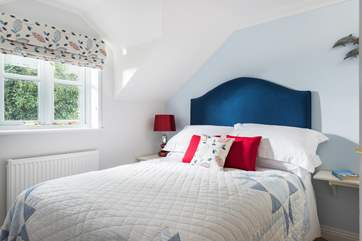 Bedroom 2 is at the rear of the cottage and is furnished with a double bed.