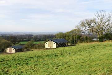 Both safari tents have plenty of space around them for games of football, cricket, rounders or kite flying.