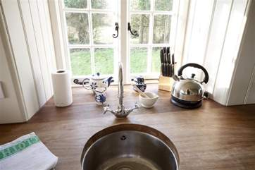 The kitchen is traditional rustic cottage in style