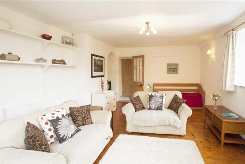 There is plenty of seating in the neutral furnished living room