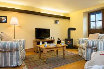 Welcoming living area with a gas effect wood-burner. Great for those cosy evenings in.