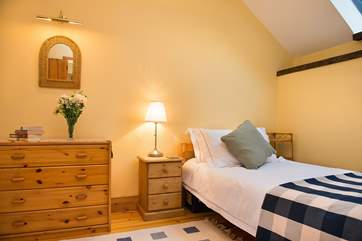 Twin bedroom, cosy and inviting.