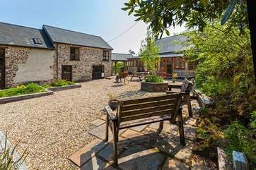 Delightful communal patio area at the rear of Saunton Cottage. This area is also used by the Owners.
