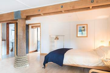 The exposed beams and pole are a real feature in this wonderful house.