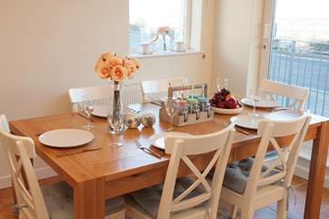 The dining-table extends to incorporate all guests when at full capacity.