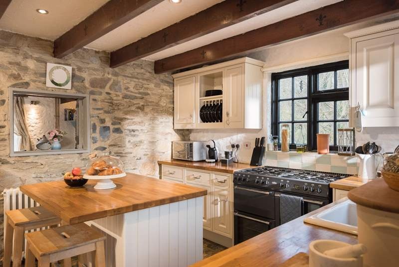 This gorgeous kitchen has a range cooker and plenty of work surface for those who like to cook.
