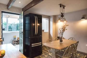 The dining-area with large American-style fridge/freezer.