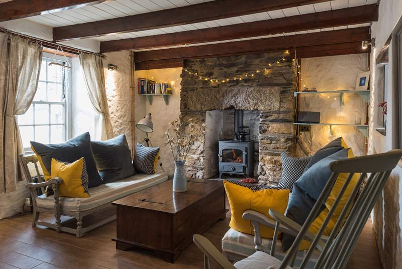 The lovely granite fireplace surrounds the wood-burner, cosy on those cooler days.