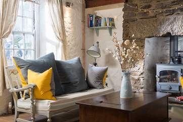 Large squashy cushions to sink into on the stylish sofa chairs.