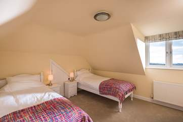 Bedroom 3 has two single beds and a built- in wardrobe and is a great room for children.