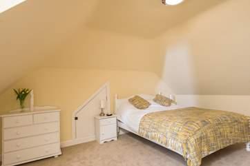 The first floor double bedroom.(Bedroom 4) has a built-in wardrobe.