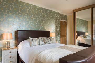 The master bedroom en suite with 6ft double bed with a hidden TV.