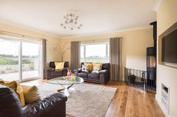 The dual-aspect sitting-room with comfy sofas and chairs for all.
