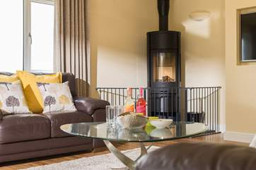 The modern wood-burner gives off a lovely glow and keeps you cosy on those cooler days and nights.