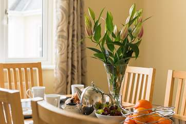 Meals with family or friends around the dining-room table.