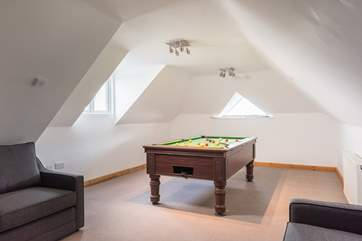 The games-room is kitted out with a snooker table and a flat screen TV.
