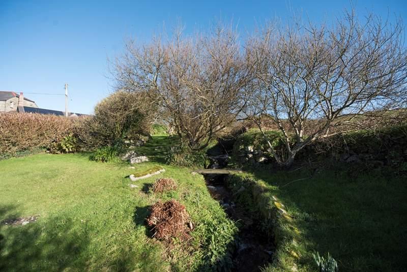 A stream runs through the garden.  Please take care with children.