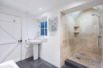 The ground floor family bathroom has a walk-in shower.