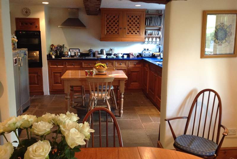 The kitchen/dining-room is a lovely open sociable space.