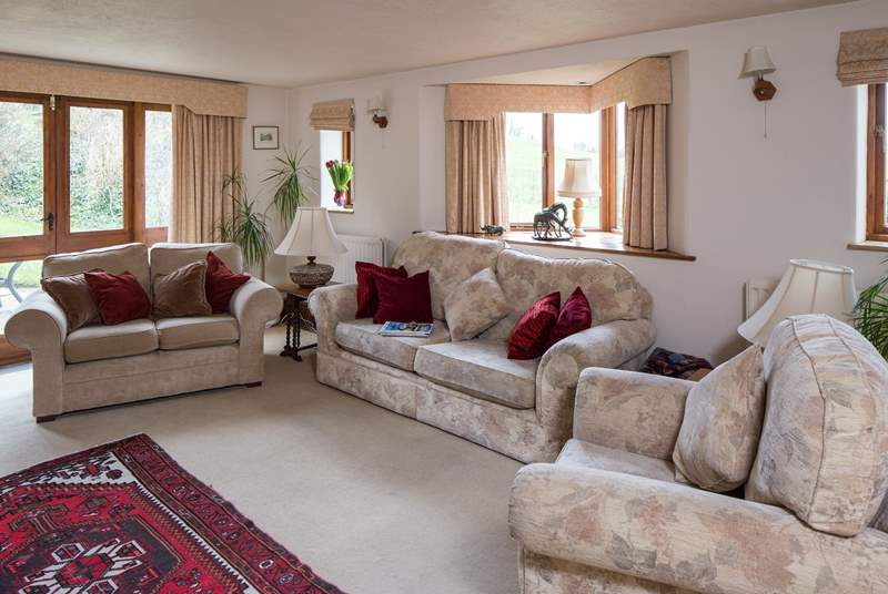 Plenty of space for all the family in the cosy sitting room, which looks out over the gardens.