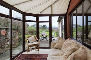 At the back of Barley House, the conservatory looks out over the garden, a great place to relax with a good book.