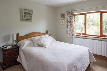 Bedroom 2  has a double bed an looks out over the garden.