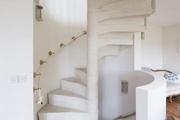 Stunning spiral staircase which takes you up to the master bedroom, down to the garden-room and out to the stunning walled rose garden.