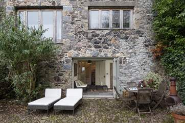 At the bottom of the stairs on the lower ground floor you will find the garden-room, a lovely space which enables you to sit inside whilst enjoying all the glory of the outside.