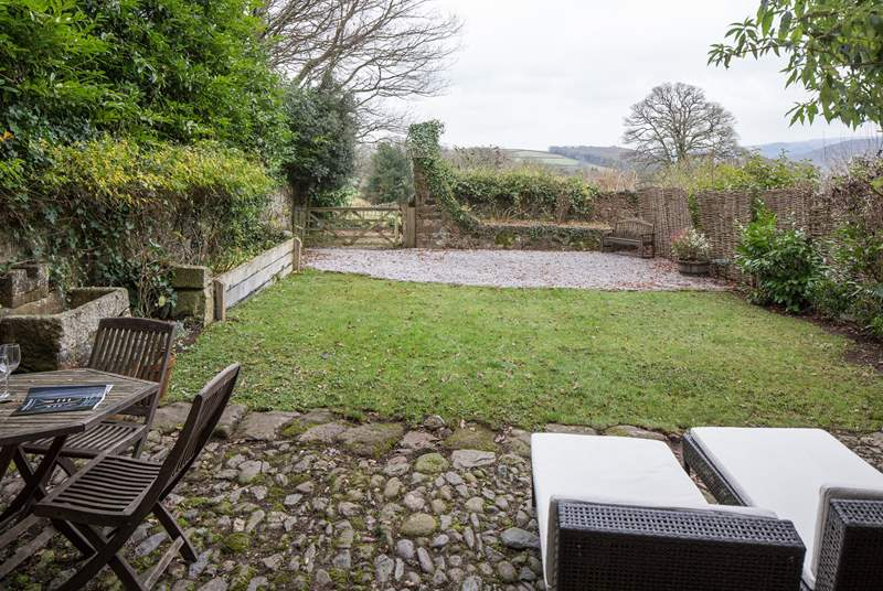 Looking out from the patio-area onto your beautifully maintained secluded garden.