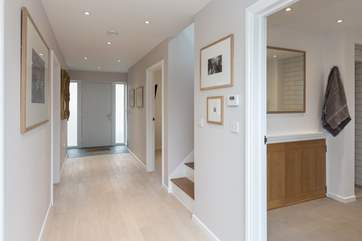 The Willows has a wide hall that links the front and back doors and gardens. With stunning original artwork by local artists on all the walls, this is a really special place to stay.