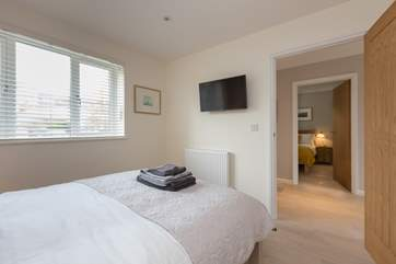 Both the double bedrooms have wall-mounted TVs.