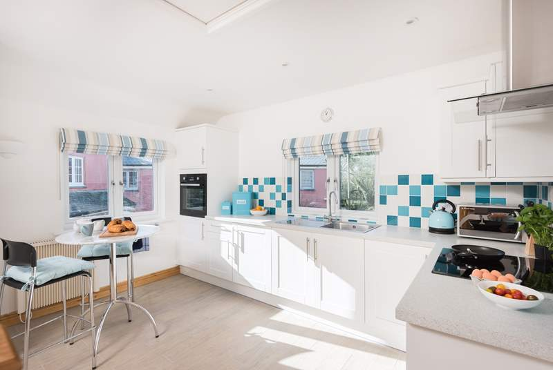 The kitchen is a light space with room to cook and dine.