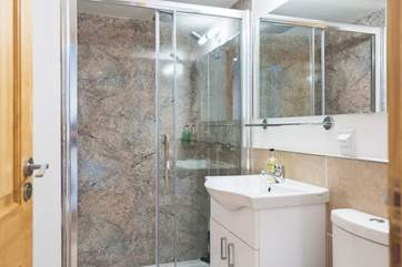 The shower-room is rather fabulous with a double-sized cubicle and large shower rose.