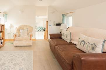 The large leather sofa and comfy armchair await you after a busy day out exploring this beautiful area of Cornwall.