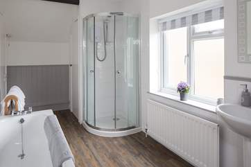 Spacious and airy bathroom, which offers both a shower and bath. Whether it's a quick shower, or a long soak in the bath you are after, this bathroom offers both.