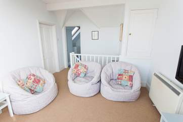 The snug is perfect for the children to watch TV whilst the adults enjoy a glass of wine on the roof terrace
