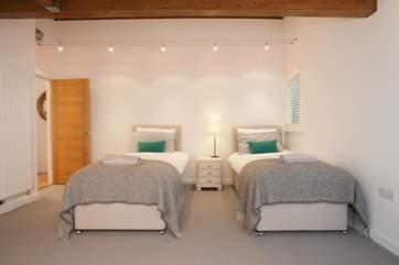 The twin bedroom is suitable for both children or adults and has access to the en suite,
