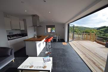 This contemporary cottage has bi-fold doors that open up the whole of the front with its stunning deck and even more stunning panoramic views.