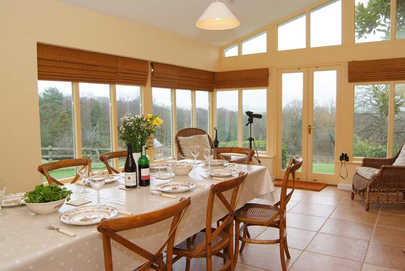 This wonderful family house has a high ceilinged garden room with a large dining area for meals with view!